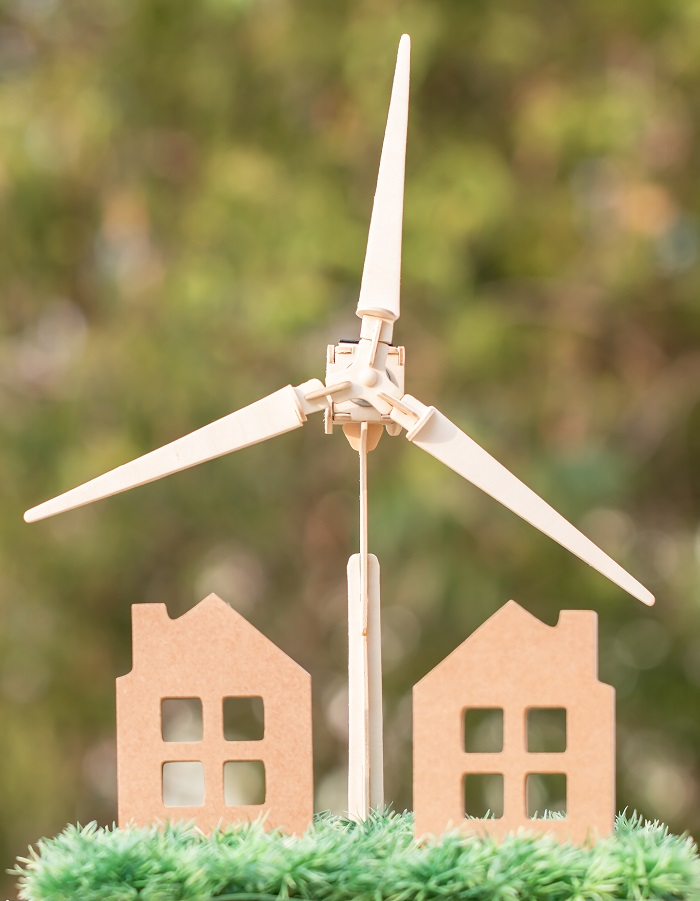 Green Energy / Future Clean Alternative energy or awareness of environment concept: Wind turbine / Wind mill with home model. Idea for sustainable eco residential family house,using ecology renewable